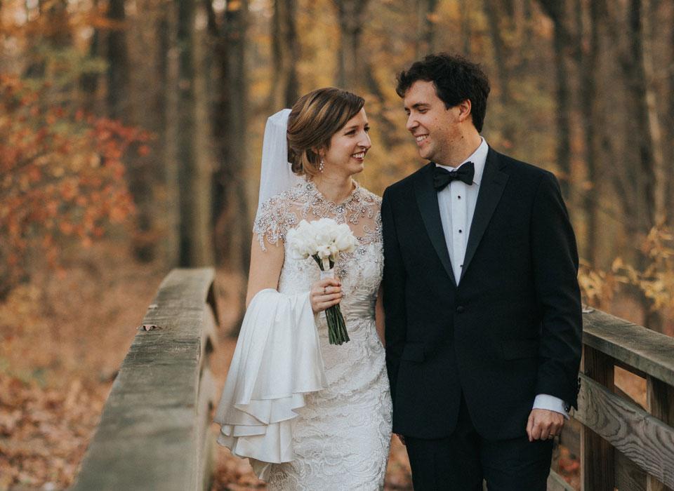 Bride and groom walking on a bridge