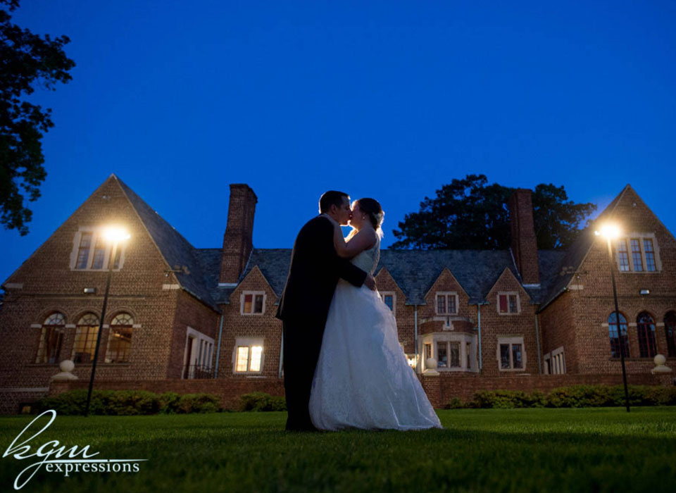 bride and groom kissing outside Moorestown Community House