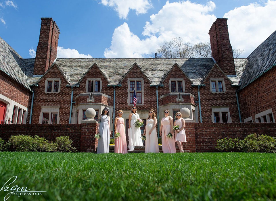Bride and her bridesmaids outsite of Moorestown Community House